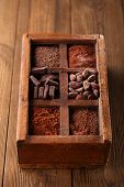 stock photo of cocoa beans  - old spicy box full of chocolate  - JPG