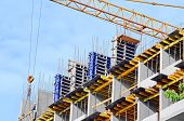 picture of construction crane  - Concrete formwork and crane on construction site - JPG