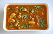 foto of paneer  - Mattar or mutter paneer is a vegetarian north Indian dish made of green peas and paneer in a tomato based sauce spiced with garam masala and garnished with coriander leaves - JPG