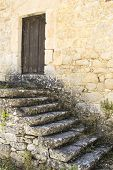 picture of blunt  - Old stone steps leading towards a wooden closed door - JPG