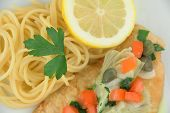 foto of artichoke hearts  - Delicious gourmet chicken picatta with noodles - JPG