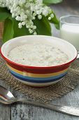 picture of porridge  - Porridge milk and lily of the valley on the table - JPG