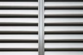 stock photo of louvers  - The aluminum louver window as long as the background of the wall - JPG