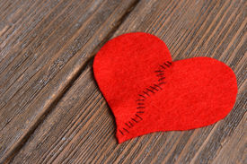 pic of heartbreaking  - Broken heart and thread on wooden background - JPG