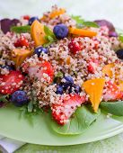 stock photo of quinoa  - Sweet quinoa salad with berries and fruits shallow depth of field selective focus
