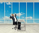 picture of fatigue  - fatigued businessman yawning and stretching oneself in the light office with big windows - JPG