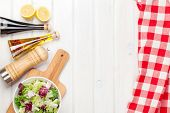 image of condiment  - Fresh healthy salad and condiments over white wooden table - JPG