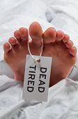 picture of autopsy  - Practical joke toe tag on a tired asleep woman - JPG
