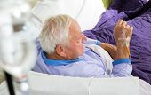 foto of intravenous  - Older man receives infusion at home, home care