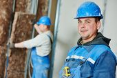 image of millwright  - cheerful plasterer worker at a indoors wall insulation works - JPG
