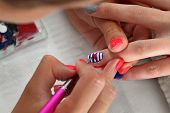 image of finger-painting  - Finger nail treatment painting heart with brush and lacquer - JPG