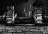 stock photo of thunder-storm  - Spooky sandstone steps in thunder and lightning storm - JPG