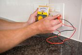 picture of  multimeter  - Metering voltage with digital multimeter in the kitchen - JPG