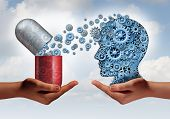 picture of science  - Brain medicine mental health care concept as hands holding an open pill capsule releasing gears to a human head made of machine cog wheels as a symbol for the pharmaceutical science of neurology and the treatment of psychological illness - JPG