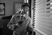 picture of peeking  - Attractive spy agent peeking from an office window film noir - JPG