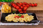 foto of italian parsley  - italian pasta with fresh tomato sauce and parsley on black dish - JPG