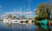 stock photo of pontoon boat  - Sailing Boats and Yachts on the Canal at Turf Lock - JPG