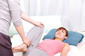 picture of chiropractic  - woman getting chiropractic at the health spa - JPG