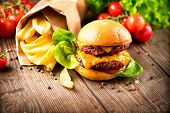 pic of french fries  - Hamburger with fries on wooden table - JPG