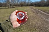 image of compasses  - Compass in the hand on a walk - JPG
