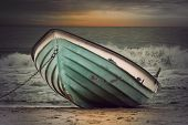 pic of boat  - Moored green row boat in rough sea at sunset vintage style - JPG