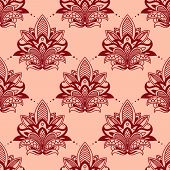 stock photo of embellish  - Seamless vintage floral tracery pattern in persian style with red flower on pink background suitable for textile or lace embellishment design - JPG