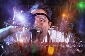 stock photo of scientist  - Portrait of a crazy medieval scientist working in his laboratory - JPG