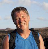 picture of bagpack  - man on walking trail thru volcanic area in Lanzarote - JPG