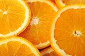 pic of valencia-orange  - background made of few sliced juicy oranges - JPG