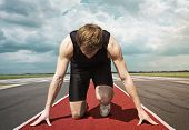 stock photo of kneeling  - Male version of airport runway starter - JPG