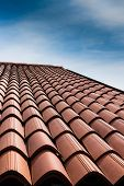 picture of red roof tile  - Vertical view of a tiled roof brown - JPG