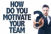 Постер, плакат: Business man pointing the text: How Do You Motivate Your Team