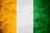 pic of ivory  - flag of Ivory Coast or banner on rough pattern texture background - JPG