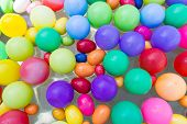 image of pool ball  - colorful plastic ball floating on water in the pool for games - JPG