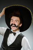 image of sombrero  - Smiling mexican with sombrero isolated on white - JPG