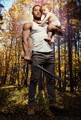 picture of little girls photo-models  - Father hugging a baby and holding a sword over forest background - JPG