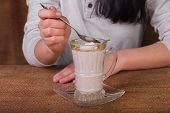 Постер, плакат: Woman eating dairy dessert spoon