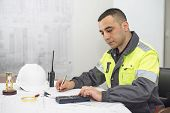 picture of engineering construction  - Civil engineer at construction office is making calculations - JPG