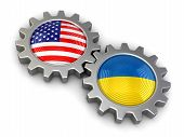 pic of snatch  - USA and Ukrainian flags on a gears - JPG