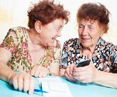 image of receipt  - Two old women consider receipts - JPG