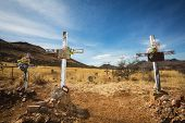 stock photo of burial  - Trio of wooden crucifix burial sites with blank signs - JPG