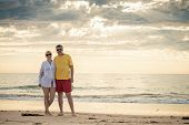 picture of fifties  - Happy mature couple in mid fifties at the beach - JPG