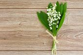 image of lilly  - lilly of the valley flowers posy on wooden table with copy space - JPG