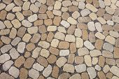 stock photo of cobblestone  - Mosaic of a footpath with an irregular pattern of oval - JPG