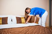 image of maids  - Image of maid making bed in hotel room - JPG
