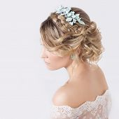 stock photo of flower girl  - beautiful young sexy elegant sweet girl in the image of a bride with hair and flowers in her hair  - JPG