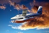 stock photo of hydroplanes  - seaplane prepare for landing against some stormy clouds - JPG