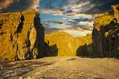 picture of midnight  - Midnight setting sun lites beautifully volcanic rocks at Thorsmork - JPG