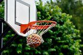stock photo of basketball  - Basketball ball flies into the shopping cart - JPG