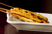stock photo of sate  - Thai chicken satay skewers with spicy peanut sauce for dipping - JPG